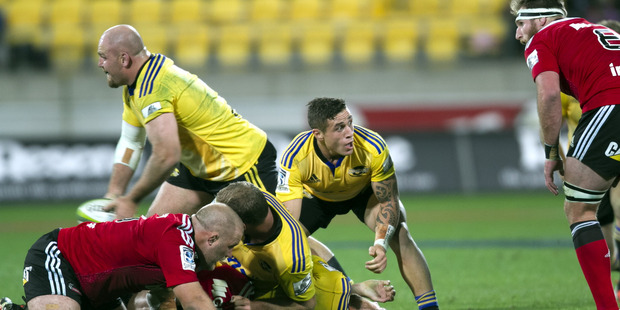 Hurricane's TJ Perenara protects the ball as acting half back Ben Franks clears the ball from the ruck during the match between Hurricanes v Crusaders. Photo / File