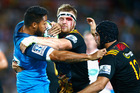 George Moala of the Blues is tackled by Sam Cane of the Chiefs during the round seven Super Rugby match between the Chiefs and the Blues. Photo / Getty Images