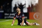 Shaun Johnson of the Warriors scores a try during the round 17 NRL match between the New Zealand Warriors and the Gold Coast Titans. Photo / Getty Images.