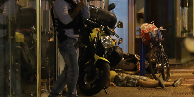 The body of a person on the ground after a van drove into a crowd watching a fireworks display in the French Riviera town of Nice. Photo / Getty