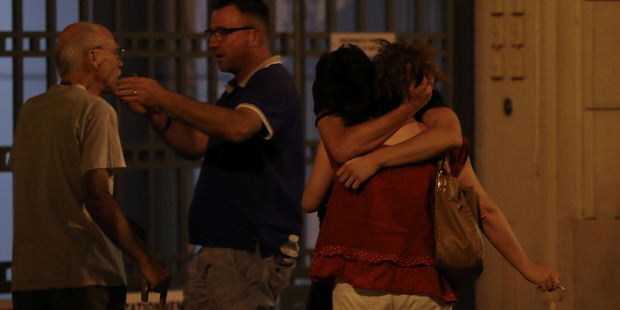 People react after the van drove into a crowd killing at least 84 people. Photo / Valery Hache/AFP/Getty Image