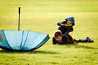 HANG ON: Jack Brittin, aged 10 and brother Hugo, aged 4, were playing in the rain last week in Havelock North's Anderson Park. PHOTO/WARREN BUCKLAND