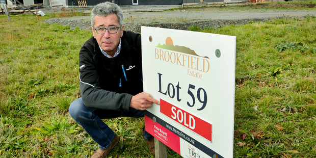 Hastings district councillor Wayne Bradshaw, in front of vacant sold sections on Brookfield Rd, Havelock North. Photo / Warren Buckland