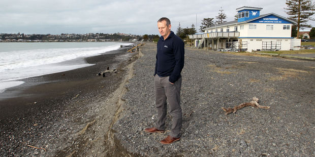 Jimmy Bowden, Westshore Surf Life Saving Club sports co-ordinator and board member, stands on Westshore Beach where more erosion is evident after higher-than-usual seas at the weekend. Photo / Duncan Brown