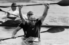 Paul MacDonald and Ian Ferguson raise their arms in the air as the line judge calls them in first and the gold medal in the K-2 500 at the Han Regatta Course. Photo / NZH Archives