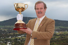 Melbourne Cup race caller Bryan Martin, with the Melbourne Cup, will be visiting Hawke's Bay on Saturday in this year's pilgrimage.