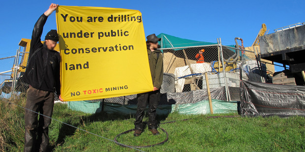 Protesters at the site on Puhipuhi mountain where the anti-mining group claims Evolution Mining is drilling.