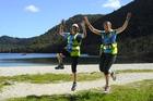 Tikitapu Trail Run participants enjoying the trails along a beach. PHOTO/SUPPLIED