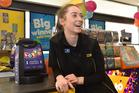 Pak'nSave Dunedin Lotto supervisor Abby Pegg celebrates a Dunedin couple's $13.3 million win. Photo / Otago Daily Times, Gregor Richardson