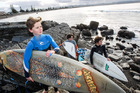 BEACH BOYS: Oscar Averill (left), Liam Gough, and Roman Walewski, all 14, surfing off Westshore yesterday. PHOTO/Paul Taylor