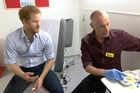 Nervous smiles from Prince Harry as he faces one of his toughest tests.