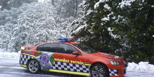 A police car in the snow in Victoria's Dandenong Ranges. Photo / Twitter, Victoria Police