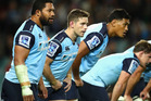 Bernard Foley of the Waratahs and team mates look on after a Hurricanes try during the round 16 Super Rugby match between the Waratahs and the Hurricanes. Photo / Getty Images.