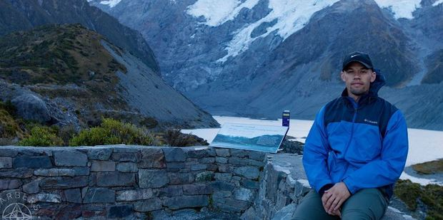 Lucas Barber, in front of Mount Cook, is travelling the world with his wife Lisa. Photo / Barbersgoglobal