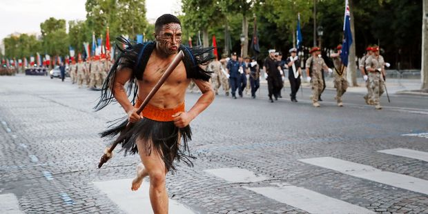 A Maori soldier runs as New Zealand's soldiers march down the Champs Elysees in Paris during a rehearsal of the annual Bastille Day military parade. Photo / Thomas Samson/AFP/Getty Images