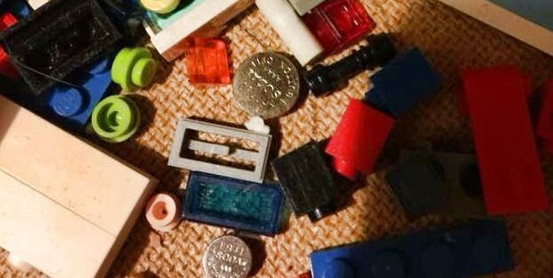 A photo of button batteries, similar to those found in a remote control, among a child's toys. Photo / Facebook