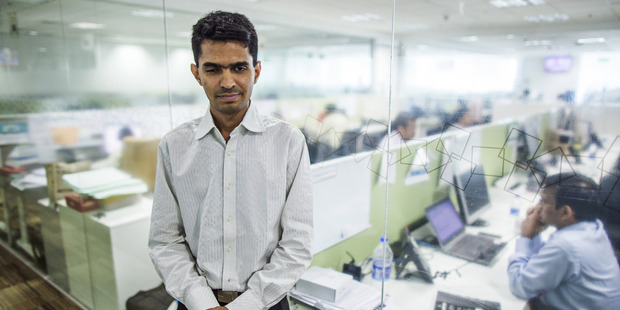 Vishal Agrawal, a foreign exchange trader at Standard Chartered, at the bank's office in Mumbai, India. Photo / Bloomberg photo by Prashanth Vishwanathan