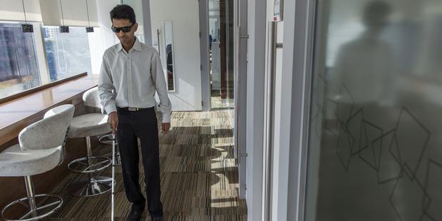 Vishal Agrawal walks through the Standard Chartered office in Mumbai, India. Photo / Bloomberg, Prashanth Vishwanathan