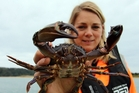 Regional council biosecurity officer Irene Middleton with one of the paddle crabs trapped at Ngunguru.