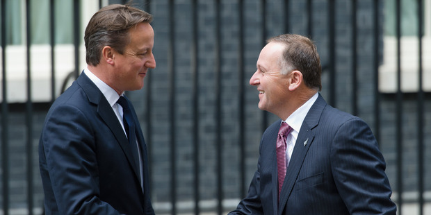 David Cameron kept John Key waiting because he had been packing up his office, farewelling staff and talking to his kids. Photo / Getty Images
