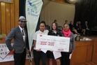 PRIZE MONEY: E Tu Whanau prize winners receive the bounty. Levi Bristow (left) from Tautoko FM, one of the Maori music stations supporting the competition, hands over the cheque to Fairy-Allen Rikihana and Te Rina Flavell-Kahle at a special assembly at Whangaroa College. On the right is Maruia Jense, HOD Maori at the college. PHOTO/SANDY MYHRE