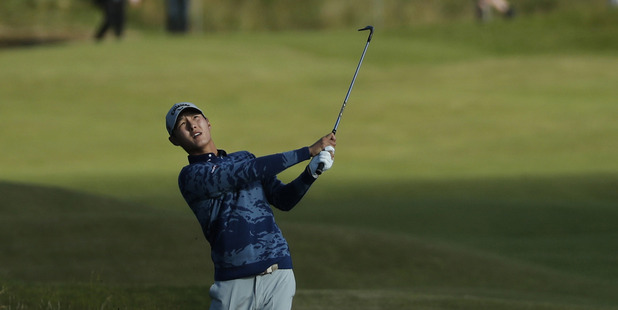 Danny Lee of New Zealand plays his shot from the rough on the 4th fairway during the first round of the British Open Golf Championship at the Royal Troon. Photo / AP