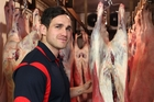 Central midfielder Cole Eru checks out some meat for a mate at a processing plant in Waipukurau. Photo / Duncan Brown