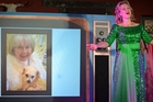 Ali Harper performs in front of a large television prop showing a photo of Doris Day herself at her 92nd birthday celebrations. Photo / Rebecca Patterson