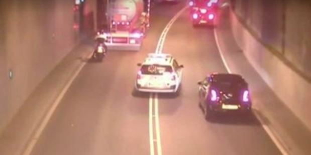 Video footage shows a driver weaving through traffic in a 'fake' ambulance. Photo / AFP Video