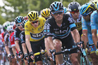 Britain's Chris Froome, wearing the overall leader's yellow jersey, rides in the pack during the eleventh stage of the Tour de France. Photo / AP
