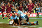 Michael Jennings celebrates as he scores the winning try in State of Origin 3. Photo /Getty