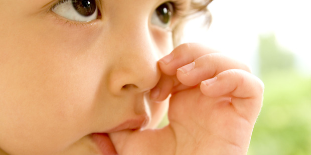 Children that sucked their thumbs or bit their nails suffer fewer allergies later in life, a new study suggests. Photo / iStock