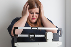 Can elevated body fat cause changes to the brain? Photo / iStock