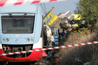 Rescuers work after a head-on collision between two trains, near Corato, in the southern Italian region of Puglia. Photo / AP