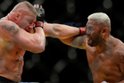 Mark Hunt fighting Brock Lesnar. Photo / AP