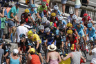 The peleton race climb during the ninth stage of the Tour de France. Photo / AP