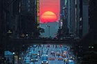 Thousands of people flooded New York streets to get the best photos of 'Manhattenhenge'.