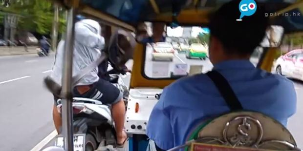 Within moments, two men on a motorbike rode past the tuk tuk and grabbed Eric Lau's bag from in front of him. Photo / GOTrip, Facebook