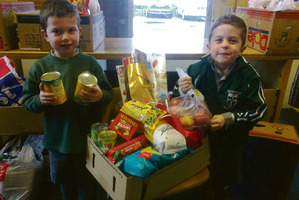 Birthday boy Callum Stauber (left) and friend Cooper Fleming proudly display the food they donated to Masterton Foodbank.