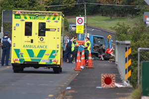 The scene of the accident on the Royal Road overbridge over State highway 16. Photo / Daniel Hines