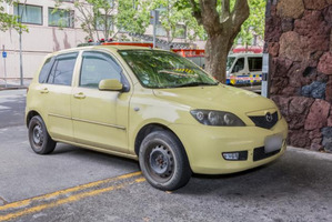 A yellow Mazda Demio car is being held in connection with the murder of Jo Pert. Photo / Supplied, NZ Police