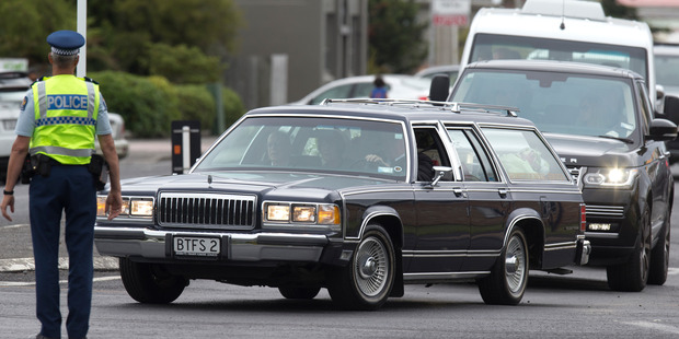 The hearse is followed by a procession of SUVs and a mini van following Jo Pert's funeral service at The Centre in Raetihi. Photo / Mark Mitchell