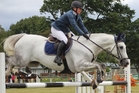 Dannevirke's Logan Massie is interviewed by Tom Castles at the showjumping championships. Photo / Christine McKay
