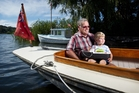 Allan Clark on Firefly with his grandson Jordan Roxburgh, 3, holding a toy boat that his grandfather made him. Photo / Stephen Parker