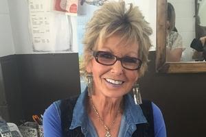 Rose Evans of Rose's Hair Care in Woodville celebrates 50 years in hairdressing. Photo / Kellie McKay