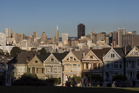 The downtown skyline stands past Victorian homes in San Francisco, United States. Photo / Bloomberg