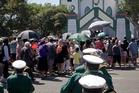 Ratana faithful file into their temple for the January 25 service.