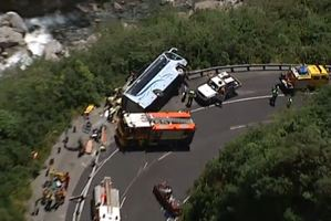 Twelve people were injured, some seriously, after a bus toppled on its side in a collision with a car in the Otira Gorge in Arthurs Pass. Photo / 3 News