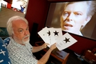 Replicant Hobbies owner Neil Lambess is encouraging people to pay a tribute to rock legend David Bowie by putting their favourite line from his many songs up in the store window. Photo / John Stone