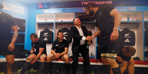 Sam Whitelock towers over Prime Minister John Key in this photo taken during the recent Rugby World Cup.